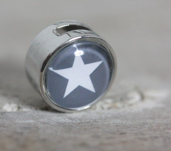 Schiebeperle grauer Hintergrund weißer Stern