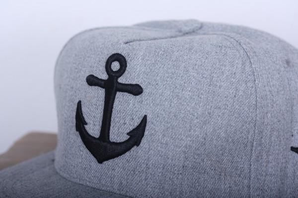 Snapback/ Cap Anker grau
