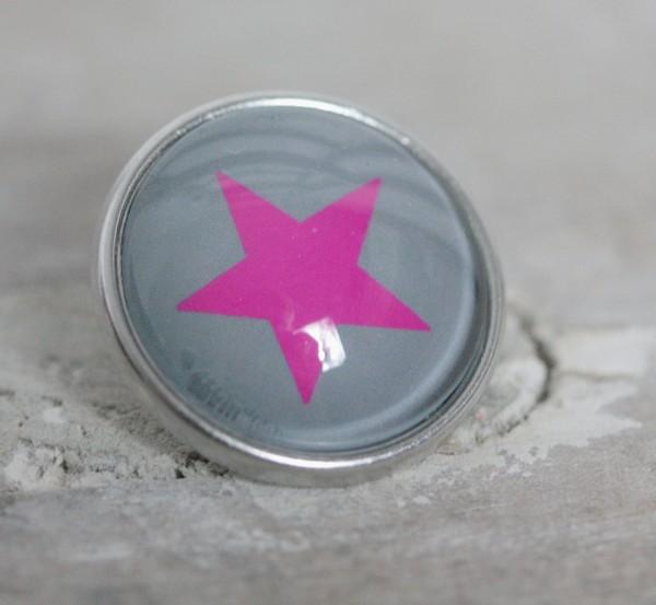 Druckknopf groß grauer Hintergrund pinker Stern